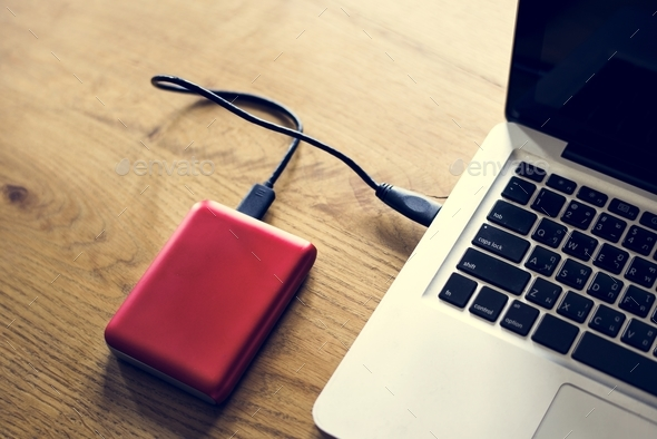 External Hard disk drive connect to laptop - Stock Photo - Images