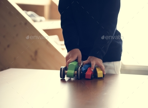 Japanese boy playing with his toy - Stock Photo - Images