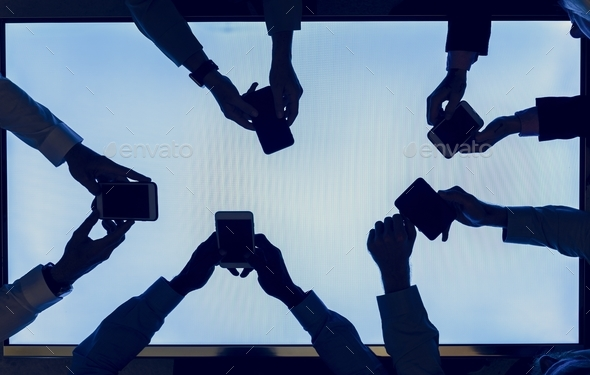 Group of silhouette hands holding smartphone - Stock Photo - Images