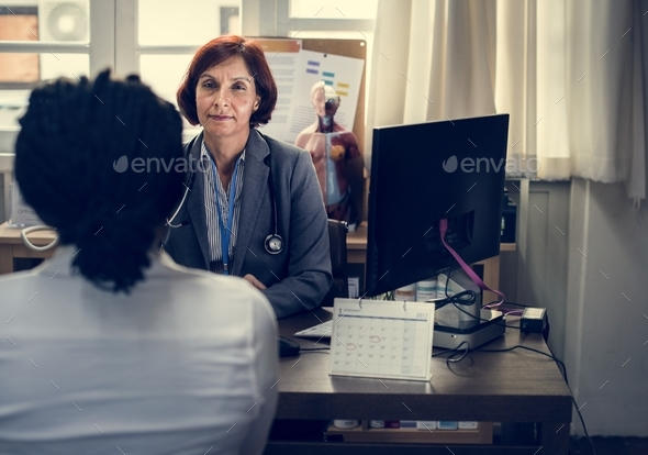 Doctor working in a hospital - Stock Photo - Images