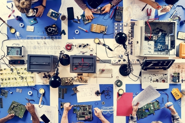 Aerial view of electronics technicians team - Stock Photo - Images