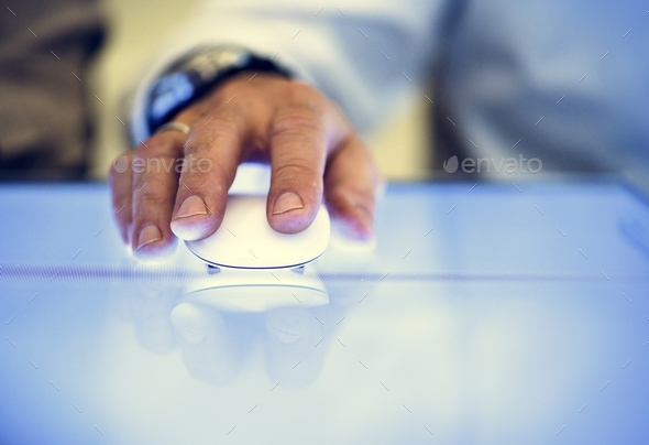 Hand holding using mouse clicking - Stock Photo - Images