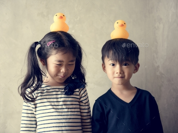 Japanese sibling playing together happiness - Stock Photo - Images