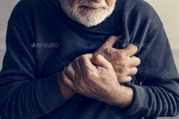 Close up of elderly man having a heart attack - Stock Photo - Images
