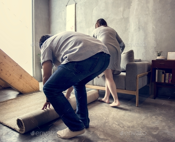 Husband and wife are helping together to cleaning - Stock Photo - Images