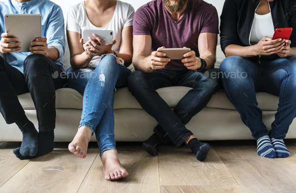 People using digital devices - Stock Photo - Images