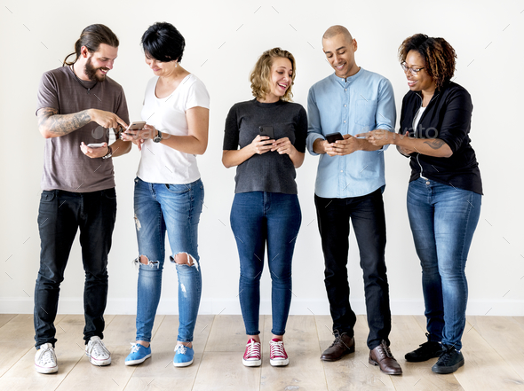 Group of people using mobile phone - Stock Photo - Images