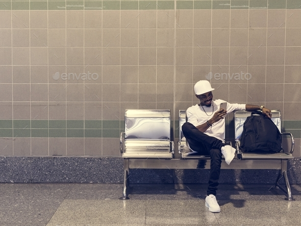 African man sitting on a waiting chair - Stock Photo - Images