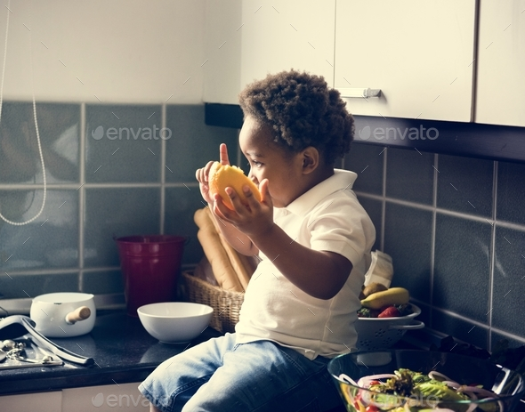 Black kid in the kitchen - Stock Photo - Images