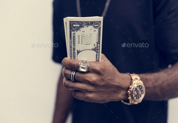 African holding cash - Stock Photo - Images