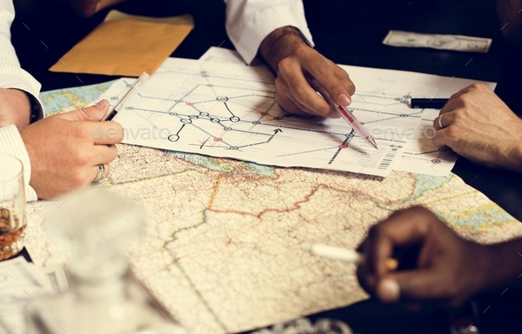 Group of people planning with the map - Stock Photo - Images