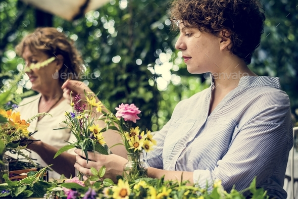 Women arranging flowers - Stock Photo - Images