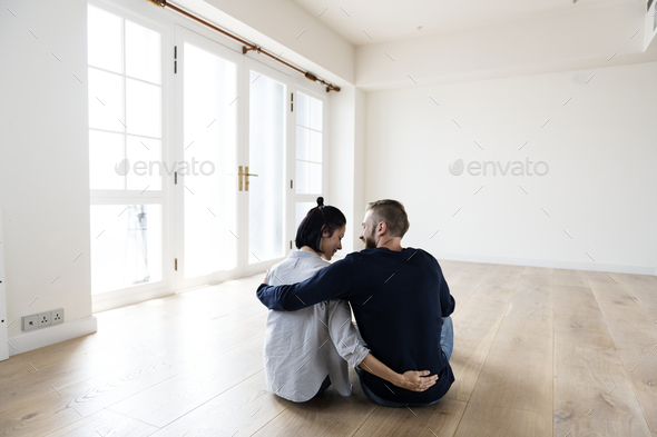 Couple move to new house - Stock Photo - Images