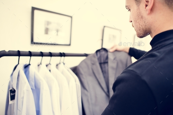 Customers shopping for clothes - Stock Photo - Images