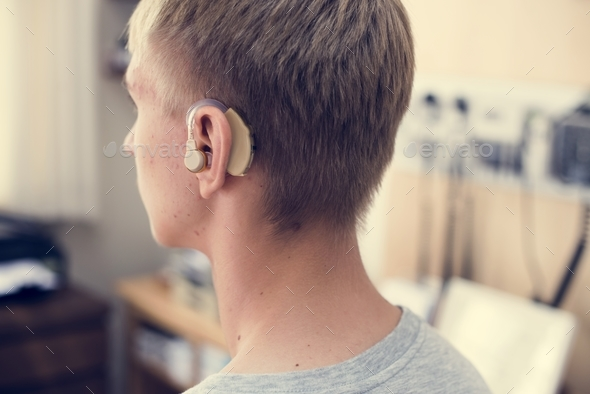 Young man with hearing aid - Stock Photo - Images