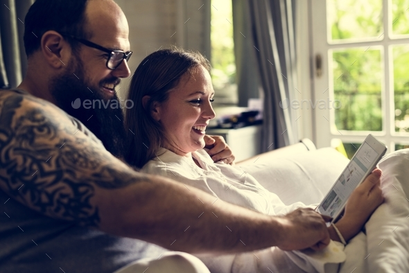 A cheerful couple is spending time together - Stock Photo - Images