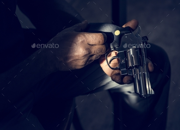 Hands holding the gun - Stock Photo - Images