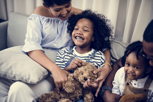 Young cheerful black kid with family - Stock Photo - Images