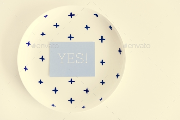 Yes word note on ceramic plate on white background - Stock Photo - Images