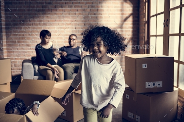Family unpacking together in new place - Stock Photo - Images