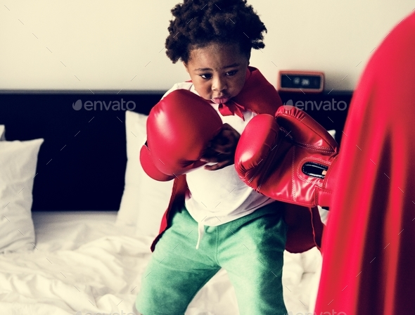 Black kid boxing - Stock Photo - Images