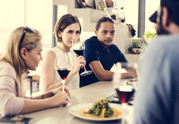 People having meal together in the restaurant - Stock Photo - Images