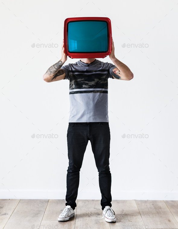 Person with tattoo holding television - Stock Photo - Images
