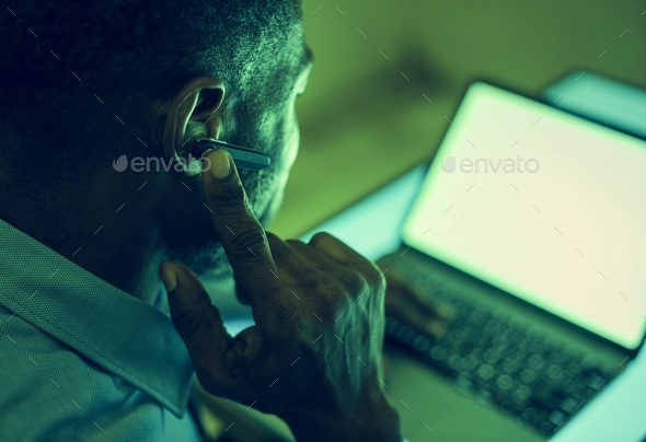 A man using bluetooth earphone device to communicate - Stock Photo - Images