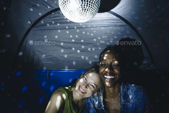 LGBT couple with disco ball - Stock Photo - Images