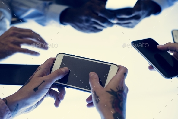 Hands holding a smartphone in a meeting - Stock Photo - Images