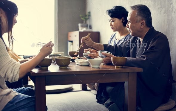 Japanese family eating together - Stock Photo - Images