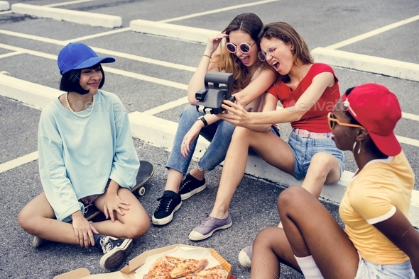 Group of diverse women taking selfie together - Stock Photo - Images