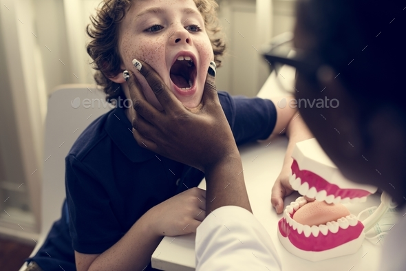 Young boy is meeting a dentist - Stock Photo - Images