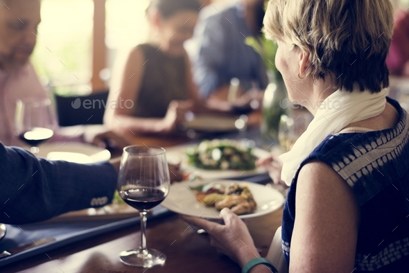 Group of diverse friends are having a dinner together - Stock Photo - Images