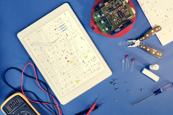 Digital tablet with a circuit diagram on a screen - Stock Photo - Images
