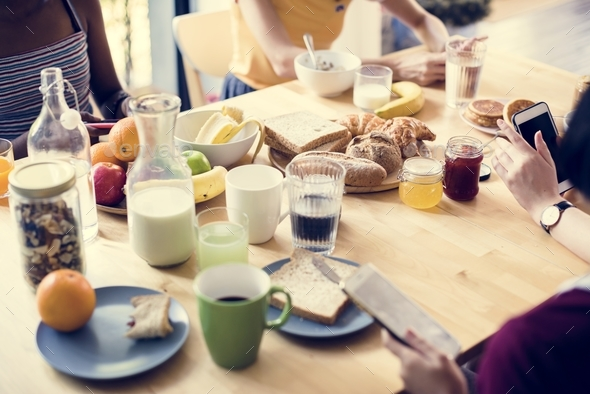 A group of diverse women having breakfast together - Stock Photo - Images