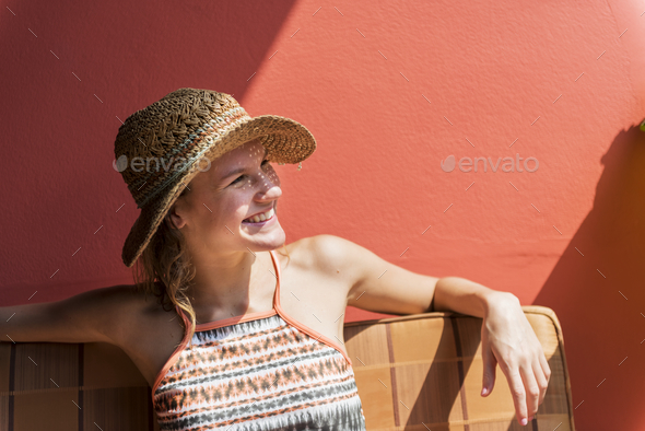 Young woman relaxing in the sun - Stock Photo - Images