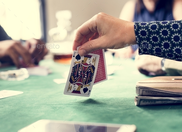 Adults socialising and playing cards - Stock Photo - Images
