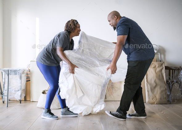 Couple moving into new house - Stock Photo - Images