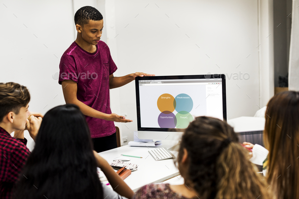 Young boy presenting a project to the team - Stock Photo - Images