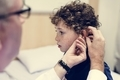 Young boy having his ears checked - PhotoDune Item for Sale