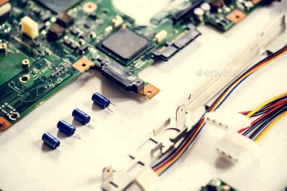 Motherboard resistors and wireisolated on the table - Stock Photo - Images