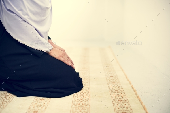 Muslim people is praying - Stock Photo - Images