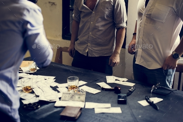 Group of people with lots of money on the table - Stock Photo - Images