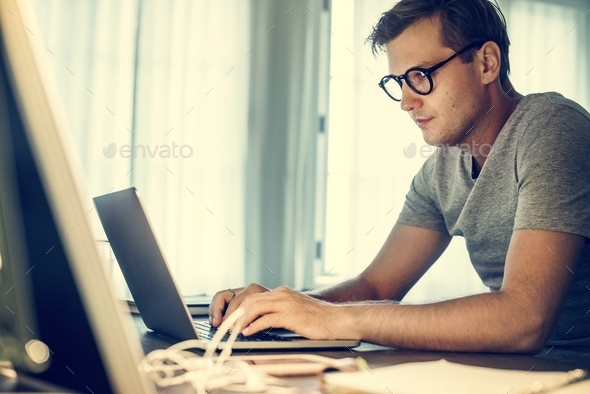 Man working on laptop - Stock Photo - Images