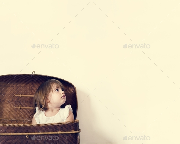 Little girl in a basket - Stock Photo - Images