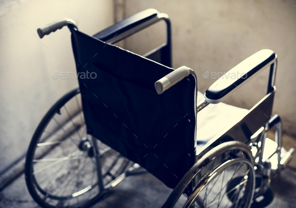 Empty wheelchair in a room - Stock Photo - Images