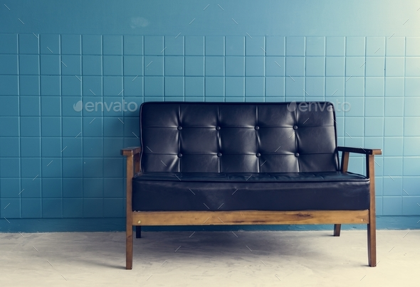 A Black Couch in a Bright Living Room - Stock Photo - Images