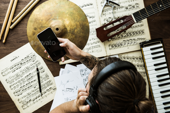 Man working with musical notes - Stock Photo - Images