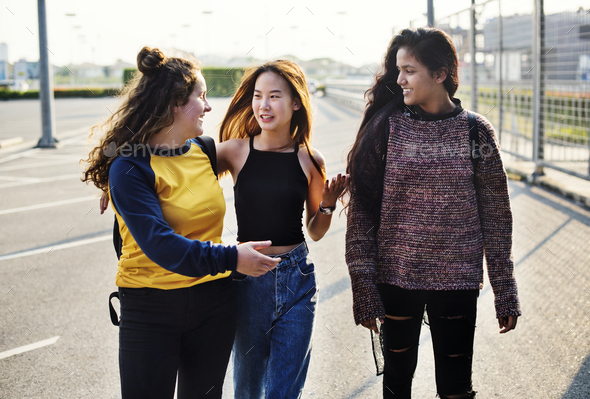 Teenage girl friends walking together - Stock Photo - Images